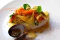 Dos de cabillaud aux coquillages, vinaigrette à la moutarde aux feuilles de coriandre & à l'orange confite